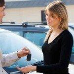 Woman getting keys for new car