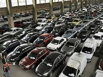 Warehouse full of bank repossessed cars