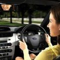 Woman test driving a car