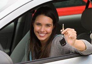 Beautiful woman in new car