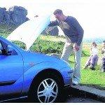 Man looking under car bonnet